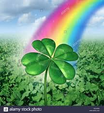 luck concept with a four leaf clover over a field of green clovers