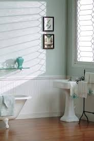 white beadboard wainscoting in bathroom with pedestal sink and