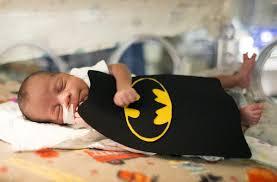 nurses volunteers dress up tiny babies in nicu at kansas city
