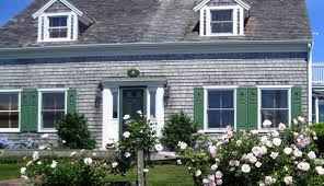 images of cape cod style homes window treatments for cape cod style homes sunburst shutters