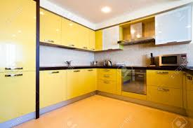 modern yellow kitchen yellow kitchen interior in modern flat stock photo picture and