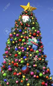 tree decorated with bright colorful ornaments outside