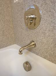 tere stone tub walls and polished nickel faucets bathroom