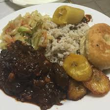 vegan oxtail cabbage plantain fried dumpling and rice and peas