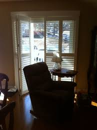 super comfortable upholstered rocking chair and plantation shutter