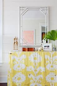 Yellow Console Table Yellow Ikat Skirted Console Table With White Bamboo Mirror