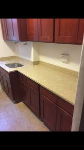 should countertops match floor or cabinets kitchen cabinets flooring and countertop doesn t match
