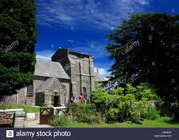 the ancient church of st nicholas studland framed by trees stock