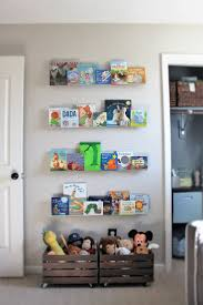 love the wooden crates for toy storage plus all the kids books on