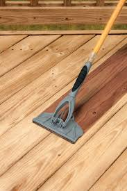 deck pro with gap wheel stain applicator for staining between