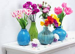 Flowers In Vases Images Beautiful Composition With Different Flowers In Vases On Wall