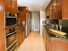cherry wood kitchen cabinets with black granite grey double bowl