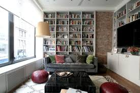 bookshelves in living room living room layout ideas place a bookcase behind your sofa