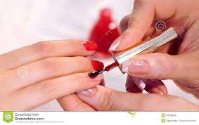 the procedure of painting nails in the spa salon manicure