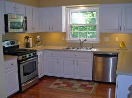 Kitchen Yellow Walls White Cabinets by What Color Cabinets For A Small Kitchen Voluptuo Us