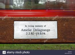 memorial plaque to amelie delagrange on a bench facing twickenham