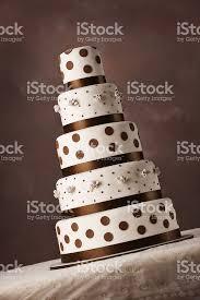 brown and creamy white 5 tier wedding cake stock photo 137806481