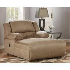 cream leather chair with recliner plus arm rest placed on the