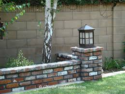 brick wall with lamp post traditional garden los angeles