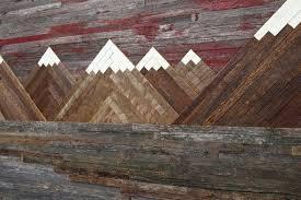 custom wood wall of a fiery sunset mountain landscape