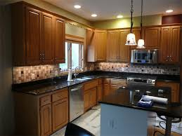 kitchen tile backsplash with colored glass accents inserts view