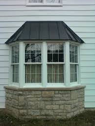 metal roof bay window clip system with seam snap cap bay