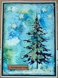 handmade card featuring a tim holtz sizzix tree die on a