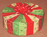 How To Wrap Gifts - how to gift wrap a round box gift wrapping 105