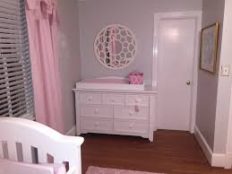 baby nursery with gray and pink wall paint benjamin moore