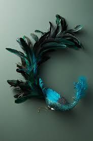 prodigious peacock ornament anthropologie