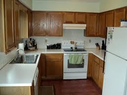 dark wood kitchen cabinets with white appliances kitchen decoration