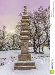 buddhist stupa in stylized japanese park in kiev in winter stock