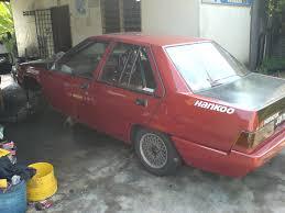 mitsubishi fiore hatchback racing with the proton saga