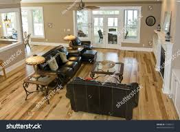 luxury livingroom maple floors leather furniture stock photo