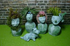 a small hearts desire miniature stone head planters finished