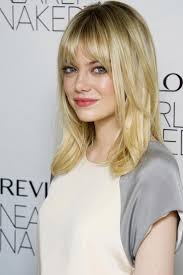 emma stone medium length straight hair with bangs and layers