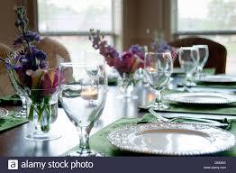 residential dinner table setting with spring flower arrangements