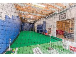 Basement Batting Cage by New Listing Real Vinings Buckhead