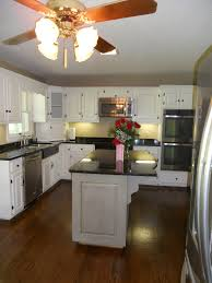 painted kitchen cabinets with contrasting island after 03