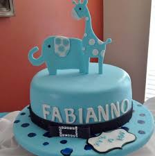 blue round animal theme baby shower cake with giraffe and elephant