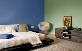 bedroom with floating bed frame and two toned wall colors