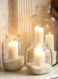 composizione di candele porta candele far da se con barattoli e sabbia progetti da