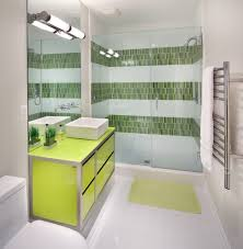 good looking green bathroom vanity with tall cabinet wall sconce