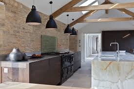 stone kitchen island in kitchen farmhouse with barn conversion