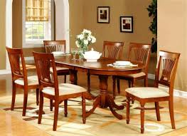 simple dining room decoration using cherry wood pedestal oval