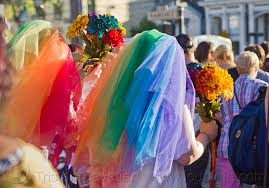 couple in rainbow color wedding dresses