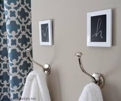 towel hooks add small frames above the hooks spray paint white