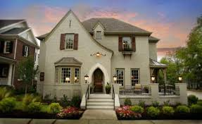 painted brick house that would match brown roof this website has