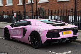 pink lamborghini car garish pink lamborghini covered in photographs of