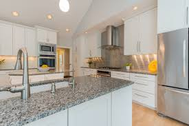 white kitchen cabinets with stainless steel backsplash modern white kitchen stainless steel appliances subway tile